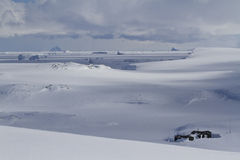 Old scientific Antarctic station of snowy expanses of the Antarc Stock Images