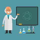 Old scientist points to chalkboard Stock Image