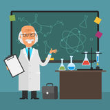 Old scientist points to chalkboard and smiling Royalty Free Stock Photography