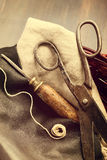 Old scissors and awl. For leathercraft vintage still-life stock photo