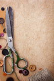 Old scissors and buttons Royalty Free Stock Photography