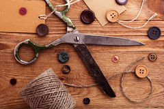 Old scissors and buttons Royalty Free Stock Images