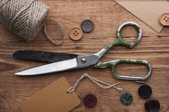 Old scissors and buttons Stock Image