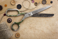 Old scissors and buttons Stock Photography