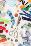 Old scissors, buttons, threads, measuring tape and sewing suppli Royalty Free Stock Photography