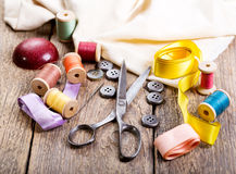 Old scissors, buttons, threads Stock Photos