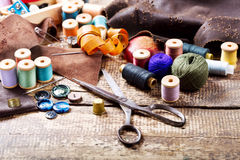 Old  scissors, various threads  and sewing tools Stock Photo