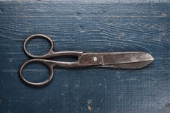 Old scissors on the wooden background Royalty Free Stock Photography