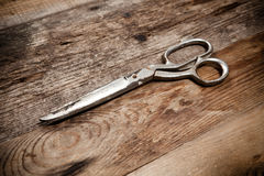 Old scissors on the wooden table Royalty Free Stock Photography