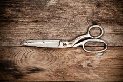 Old scissors on the wooden table Stock Photo