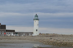 Old Scituate Light in Southeastern Massachusetts. Rocky shore with Old Scituate Light in Southeastern Massachusetts royalty free stock photo
