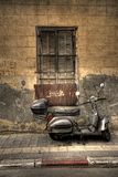 Old scooter. Lean against old wall Stock Images
