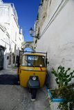 Old scooter in an alley in the old town of Ostuni, La Citta Bianca royalty free stock image