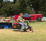 An old scooter being driven at an annual fair in kentucky stock images
