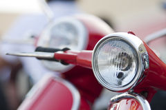 Old scooter headlight vs new on the background Stock Image