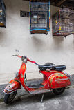 Old scooter parked in a small alley Stock Photography