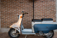 Old scooter with the wall. Royalty Free Stock Images