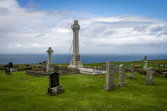 An old Scottish cemetry looking over the sea. A beautiful graveyard to lay down in peace Stock Images