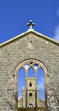 Old Scottish Church. View of the roofless ruins of St. Colmac`s church looking through the tracery on west elevation to tower on east elevation, Isle of Bute Royalty Free Stock Image