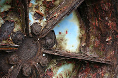 Old, scrapped, blue and red tractor wheel. Royalty Free Stock Images
