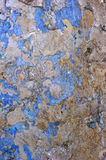 Old Scratched Concrete Wall. Old scratched wall with peeled blue paint Royalty Free Stock Photography