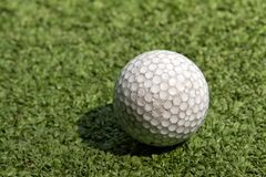 Old scratched dirty golf ball Royalty Free Stock Photography