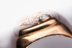 Old scratched golden ring with diamond fissure Stock Photography
