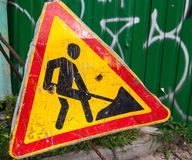 Old scratched metal roadworks sign Royalty Free Stock Image