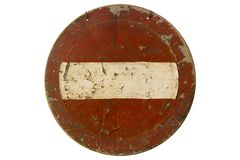 Old scratched round red road sign `Do not enter` isolated on whi Stock Photos