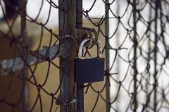 Old, scratched and rusty from time to time padlock stock photos