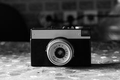 Old scratched vintage camera. Lying on the old bedspread Royalty Free Stock Photo