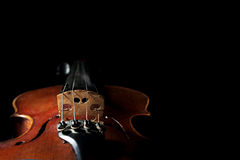 Old scratched violin on dark background. Stock Photo