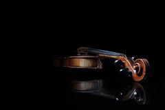 Old scratched violin, reflected in black mirror surface Royalty Free Stock Image