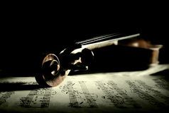 Old scratched violin in shadow Royalty Free Stock Images