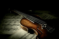 Old scratched violin in shadow Stock Photo