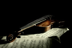 Old scratched violin in shadow Stock Images