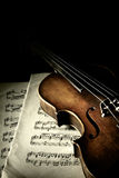 Old scratched violin in shadow Stock Photos