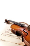 Old scratched violin on white background Stock Photos