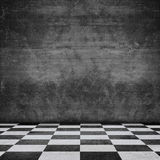 Old scratched wall chequered pattern floor Royalty Free Stock Photography