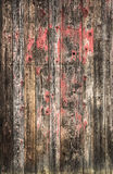 Old scratched wooden planks background with red paint, texture Stock Photography