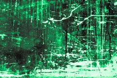 Old scratchy wooden board with colors and chalk mainly green Royalty Free Stock Photography