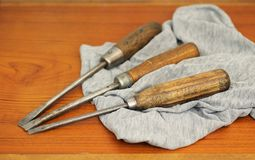 Old screw-drivers. Three old screw-drivers on the rag in the workroom royalty free stock photos