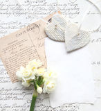 Old script with flowers and hearts Stock Photo
