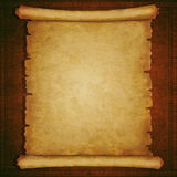 Old scroll paper on vintage wooden background Royalty Free Stock Image