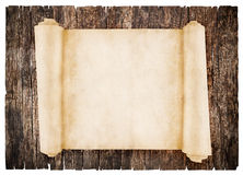 Old scroll paper. On wood background Stock Photography