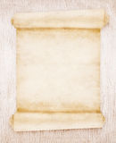 Old scroll paper. On wood background Stock Images