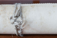 Old scroll paper on wooden background. Close up of rope Stock Photos