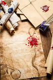 Old scrolls, sealing wax, old envelope and blue ink. On wooden table Royalty Free Stock Photography
