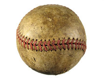 Old scuffed baseball. An old scuffed baseball isolated with a white background Royalty Free Stock Image