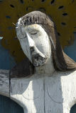 Old sculpture of  Jesus Christ. Old wood sculpture of  Jesus Christ on a cemetry Stock Photo